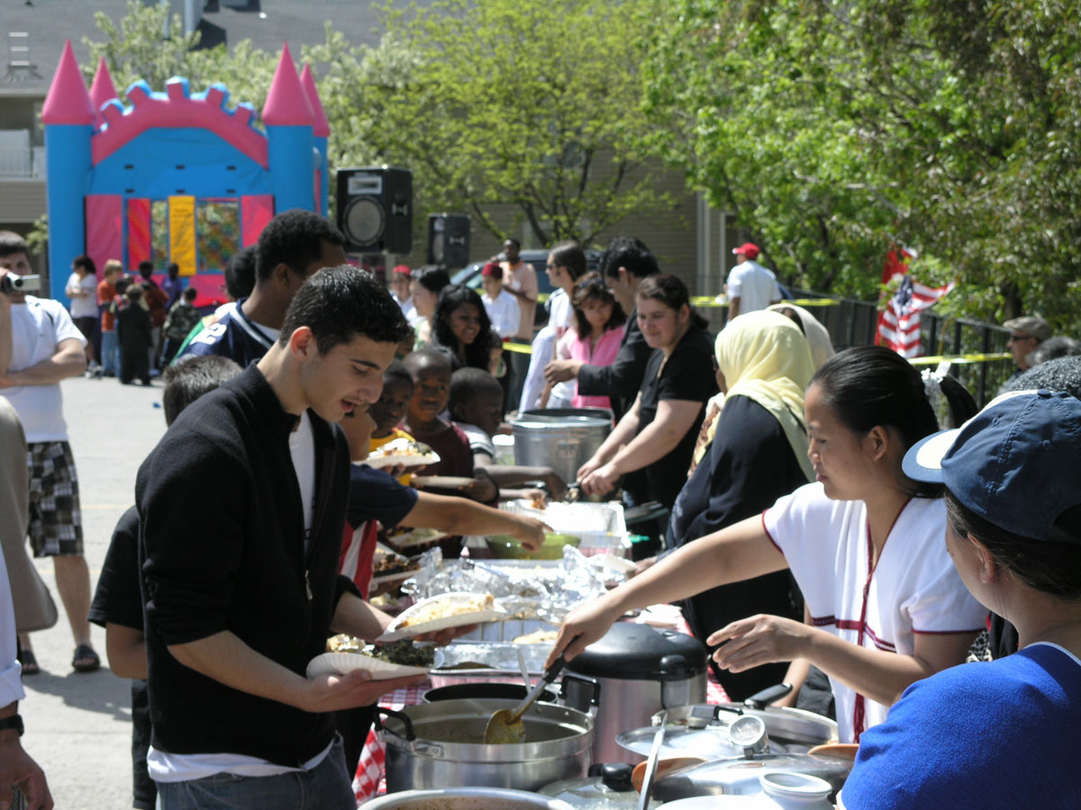 Serving food at community event