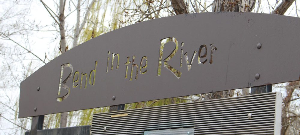 Sign saying Bend in the River
